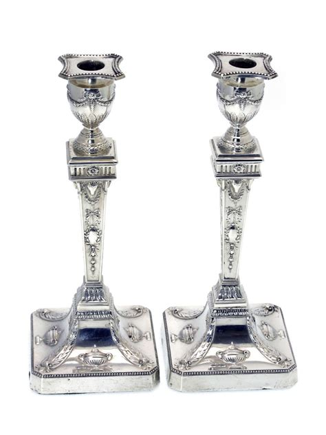 silver candlestick by loofs adam pair of adam style silver candlesticks c 1901 460267