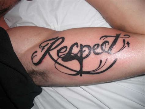tattoo on inner shoulder loyalty respect tattoo on man right shoulder