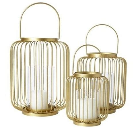 Outdoor Hurricane Candle Holders Add A Touch Of Gold To Any Outdoor Wedding