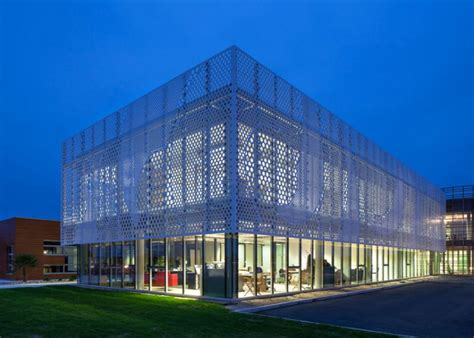 pattern energy group headquarters pad architects wraps french office with a wavy perforated