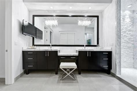 contemporary master bathroom with dark wood vanities a black double vanity modern bathroom beach chic design