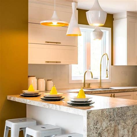 white kitchen with yellow accents waterfall countertops design decor photos pictures