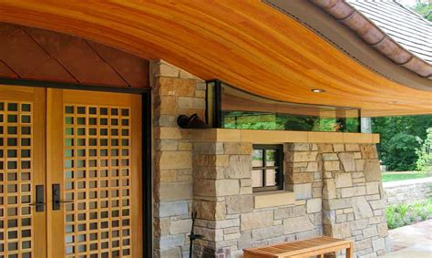 bjella architects modern home front entry  curved roof