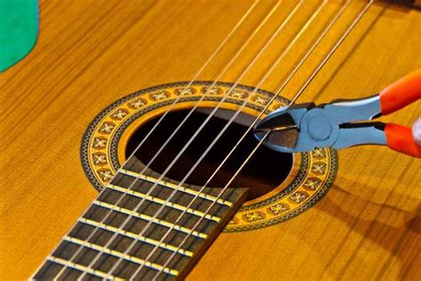 Guitar String - how to string a classic guitar the tim method of
