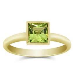 shop 14k yellow gold bezel set princess cut peridot ring