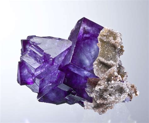 deeply colored purple fluorite with calcite irocks