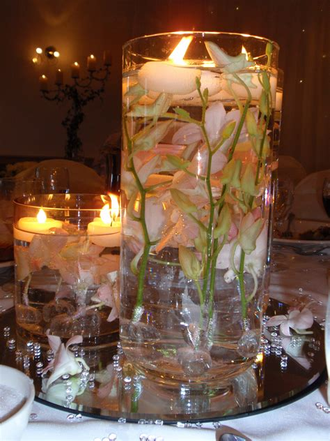 table centerpieces with candles diy wedding centerpieces floating candles with orange