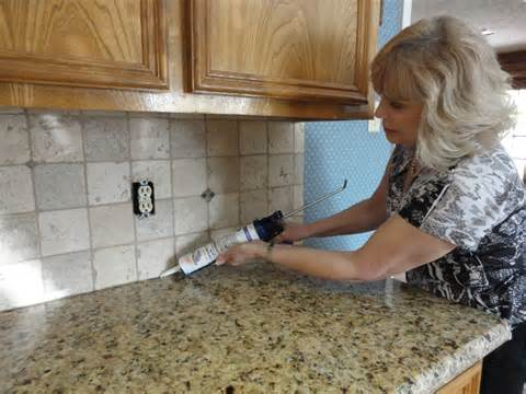grouting a backsplash to countertop joint with latex caulking tile your world