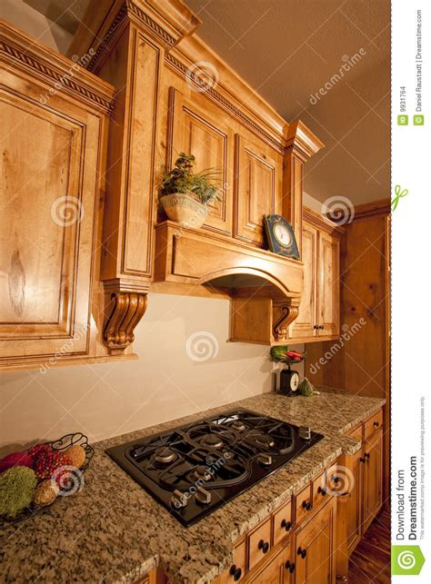 modern home kitchen cabinets range hood stock photo