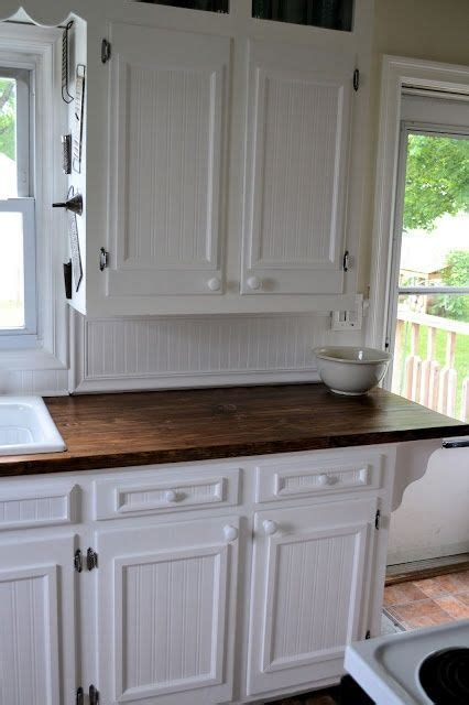 add trim to flat panel kitchen cabinets     to remake
