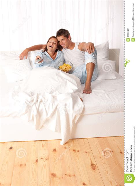 lying down in bed young couple lying down in white bed stock photo image 10660410