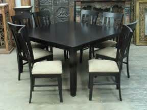 stylish black dining room table and chairs