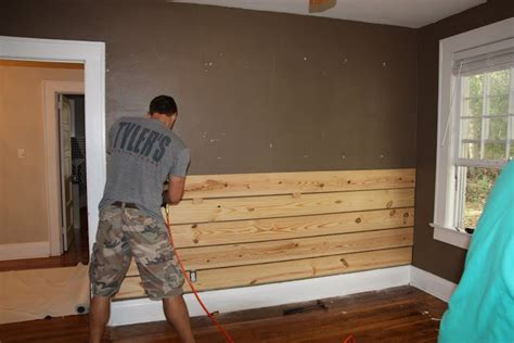 pine boards on one wall behind bed carter s cabin