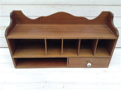reserved wood wall shelf with cubbies and drawer desktop
