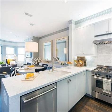 gray flat front kitchen cabinets with white marble