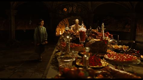 At The Table by Pan S Labyrinth 2006 Grapes Innocence