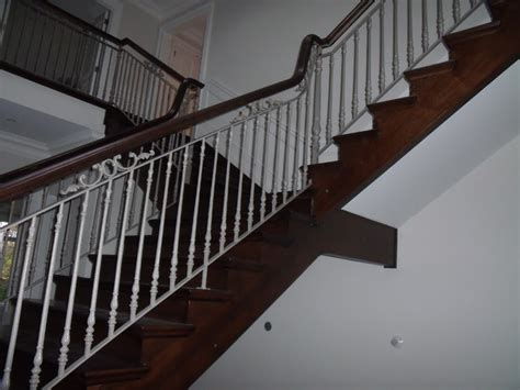 staircase railings wrought iron scroll design powder coated in a white traditional