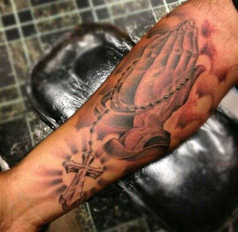 rosary praying hands catholic tattoo on forearm
