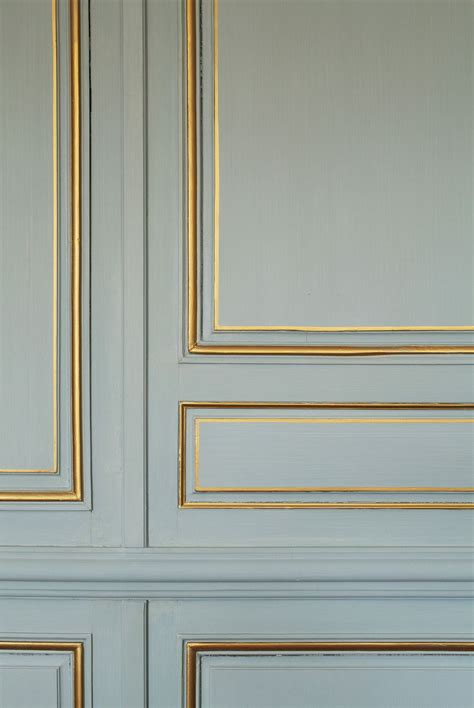 painting an accent wall for your nj home design build pros use gold paint to accent your moldings studio apartment