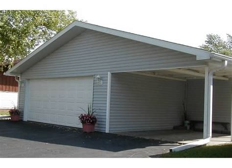 plus carport 2 car oversize garage with workshop storage plus carport