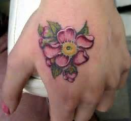 flower hand tattoo hand flower tattoo by kim reed tattoonow