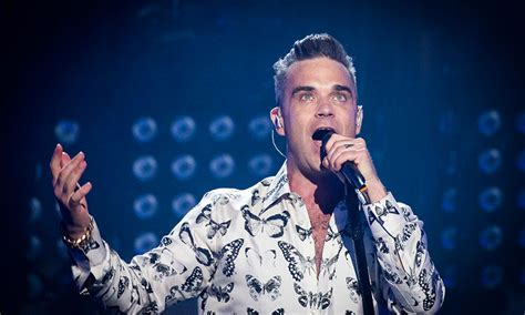 Someone Doesnt Like Robbie Williams by Robbie Williams Reveals Teddy Doesn T Care About