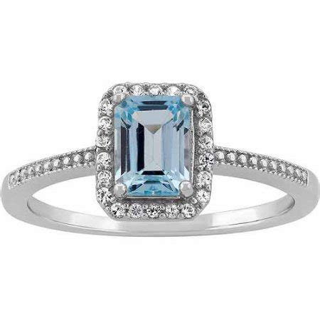 blue topaz and cz sterling silver emerald cut halo ring