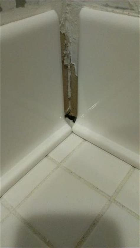 gap between outside edge of casing and wall fine ceramic tile baseboard installation question calk base