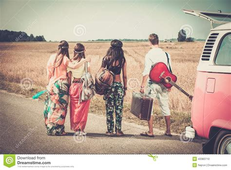 Multi Trip multi ethnic hippie friends on a road trip stock photo