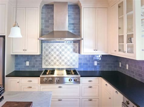light blue subway tile backsplash and white kitchen