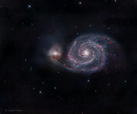 whirlpool galaxy whirlpool galaxy glows purple and blue in amateur photo