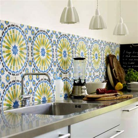 stainless steel counters and moroccan tile backsplash