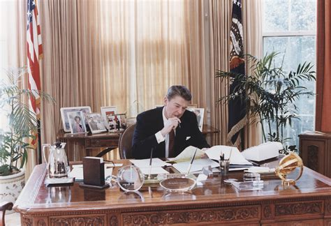 reagan oval office file photograph of president reagan working at his oval
