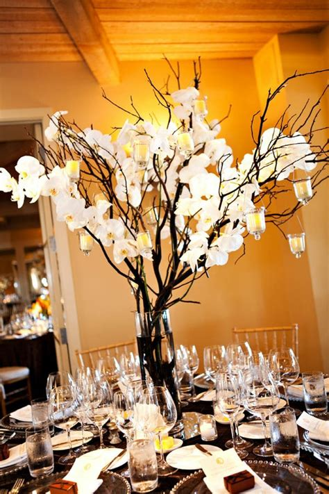 pin branches centerpiece with orchids minus the candles