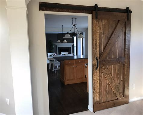 How To Install A Barn Door Build And Install A Sliding Barn Door Diywithrick