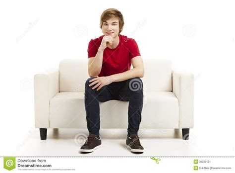 sitting on the sofa young man sitting on the couch stock image image 36228121