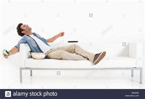 the couch guy single man on the couch watching tv stock photo royalty