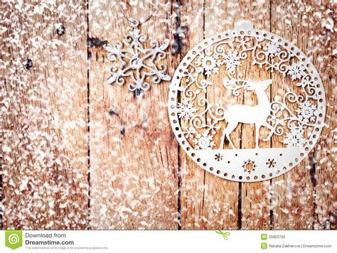 white christmas ornaments on rustic wooden board stock