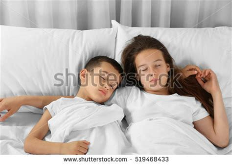 brother and sister in bed brother sister lying on carpet stock photo 519468256