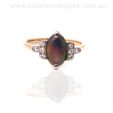 opal deco ring platinum and gold solid black opal and deco ring