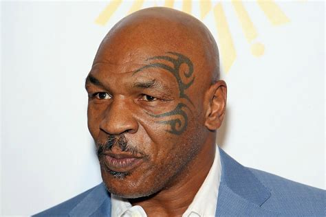 tyson face tattoo who got mike tyson style black henna left with