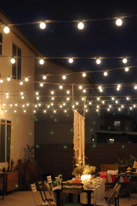 backyard lights stringing lights over a table creates a quot ceiling quot and