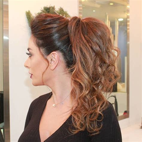 hairstyles for curly hair in a ponytail 30 eye catching ways to style curly and wavy ponytails