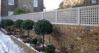 Garden Fence Trellis Top Trellis Painted Light Grey On Top Of Brick Wall Raised