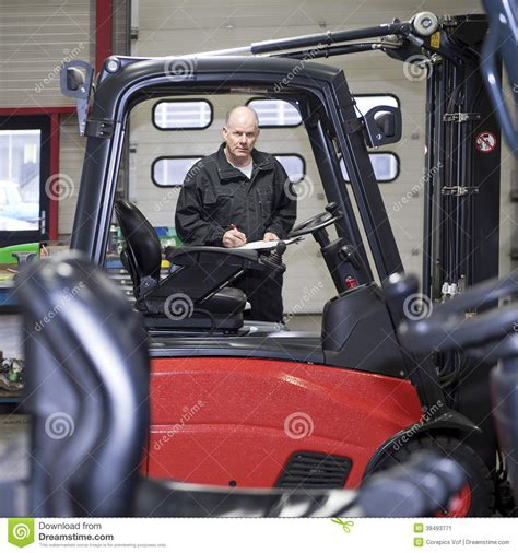 Forklift Technician by Forklift Mechanic With Clip Board Stock Image Image 38493771