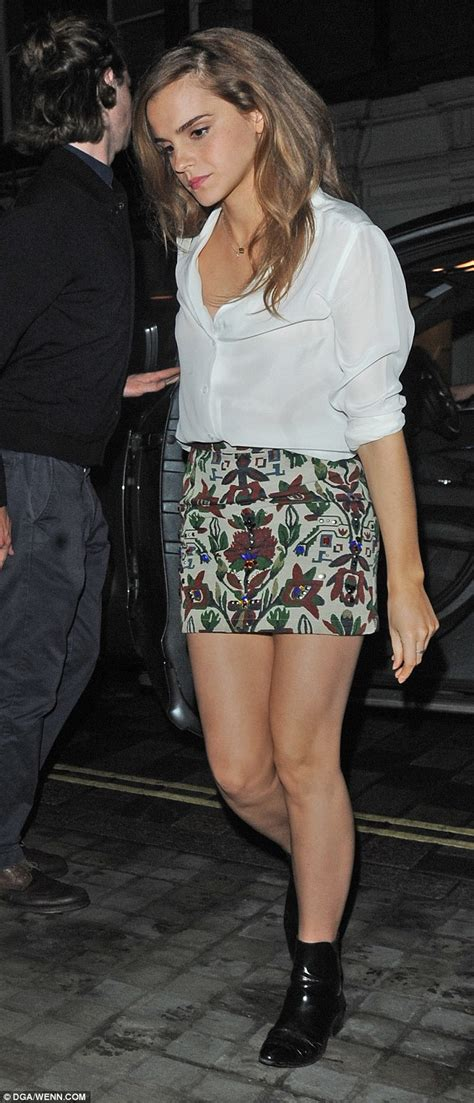 while the miniskirt has been emma watson showcases her toned legs in patterned mini