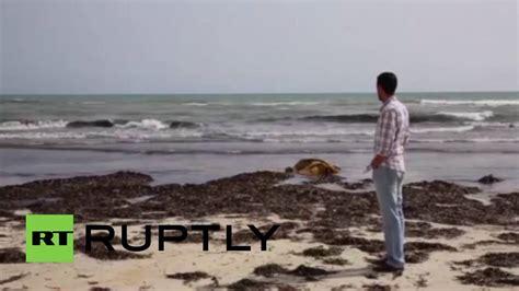 refugee boat libya libya 100 bodies wash ashore after refugee boat capsizes