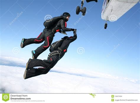 Track Jump Up Planes two skydivers jump from a plane stock images image 14247454