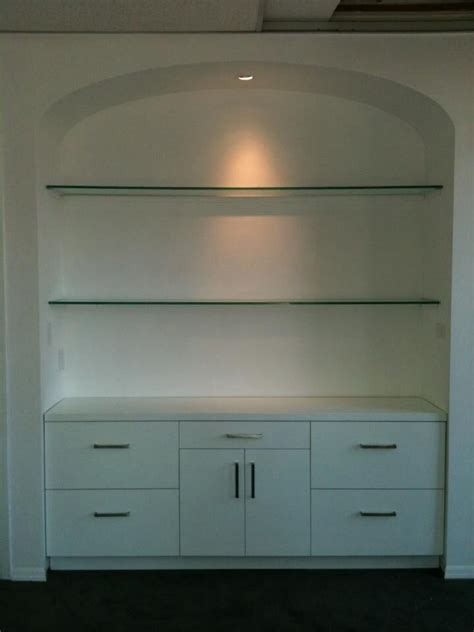 hand made arched alcove with built in filing cabinet by