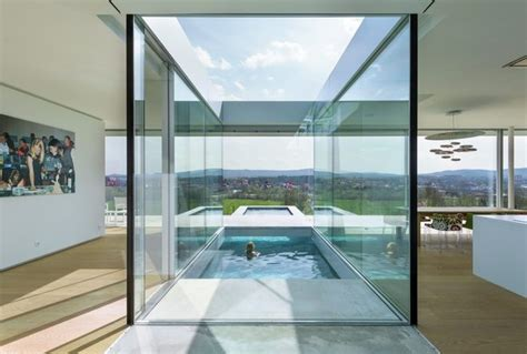 home lighting design principles floating pool cuts directly through modern glass house in